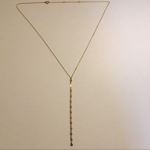 Gold plated necklace with gold chain. Never worn.